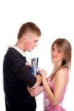 Couple students over a white background Stock Photos
