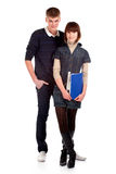 Couple students over a white background Royalty Free Stock Photo