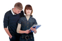 Couple students over a white background Stock Photography