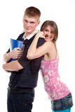 Couple students over a white background Royalty Free Stock Image