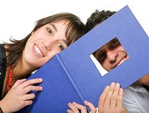 Couple of students with photobook Stock Photography