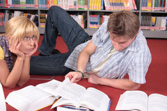 Couple of students preparing to the exam Royalty Free Stock Photos