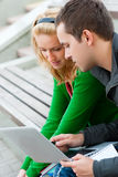 A couple of students studying. Together Royalty Free Stock Image