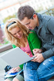 A couple of students studying Royalty Free Stock Photos