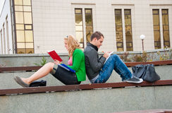 A couple of students studying. Together back to back Stock Image