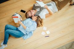 Couple studying while lying on floor at home Royalty Free Stock Images