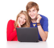 Couple students studying together with laptop Royalty Free Stock Image