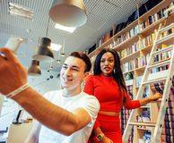 Couple students in univercity library, looking book, preparing t. O exam, having fun, making selfie, lifestyle people concept close up Stock Photo