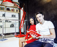Couple students in univercity library, looking book, preparing t. O exam, having fun, making selfie, lifestyle people concept close up Stock Image