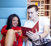 Couple students in univercity library, looking book, preparing to exam, having fun, making selfie. Close up Stock Photo