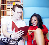 Couple students in univercity library, looking book, preparing to exam, having fun, making selfie, lifestyle people. Concept close up Royalty Free Stock Photography