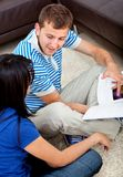 Couple studying at home Stock Image