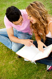 Couple studying outdoors Royalty Free Stock Image