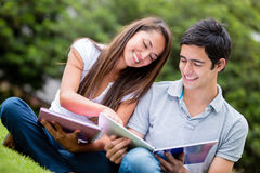 Couple studying at the park Royalty Free Stock Photography