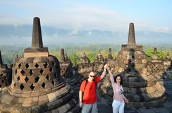 Couple between stupa at Borobudur Temple Indonesia.  Royalty Free Stock Photo