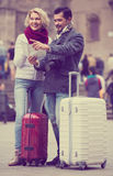 Couple with suitcases, camera and map outdoors Stock Image