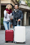 Couple with suitcases, camera and map outdoors Stock Images