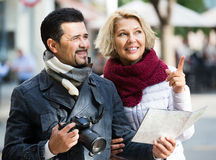 Couple with suitcases, camera and map outdoors Royalty Free Stock Photo