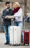 Couple with suitcases, camera and map outdoors Royalty Free Stock Image