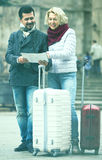Couple with suitcases, camera and map outdoors Royalty Free Stock Images