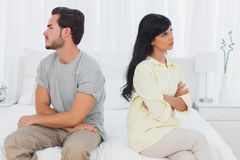 Couple sulking with arms crossed Royalty Free Stock Photos