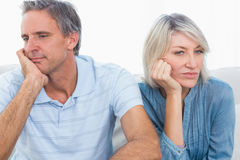 Couple sulking after a fight stock photos