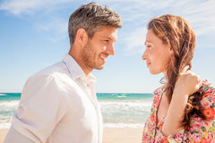 Couple summe lifestyle. Successful couple on beach flirting Royalty Free Stock Photos
