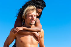 Couple in summer at the beach Stock Images