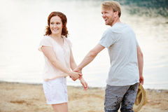 Couple in summer at beach Stock Images