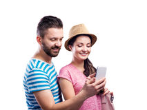 Couple in summer clothes with smartphone, taking selfie Stock Image