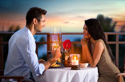 Couple on summer evening having romantic dinner. Happy couple on summer evening having romantic dinner outdoor Stock Image