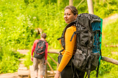 Couple in summer hike with backpacks Stock Images