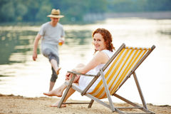 Couple in summer on a lake Royalty Free Stock Photos