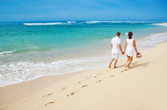 Couple in summer. Wedding couple walk on the beach Royalty Free Stock Image
