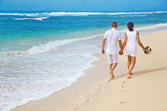 Couple in summer. Wedding couple walk on the beach Stock Images