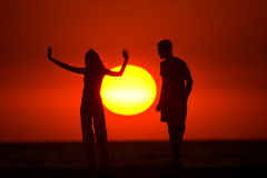 Couple and sun Stock Image