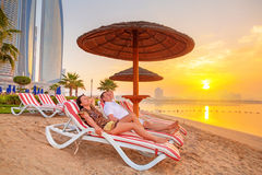 Couple on sun holidays at the Persian Gulf Royalty Free Stock Images