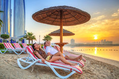 Couple on sun holidays. At the Persian Gulf, Abu Dhabi Royalty Free Stock Photography