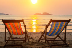 Couple of sun loungers on the beach during sunset. Nature. royalty free stock image