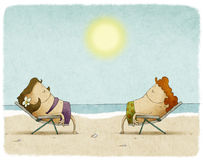 Couple sunbathing on deck chairs Stock Photos