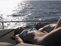 Couple Sunbathing On Yacht Royalty Free Stock Photography