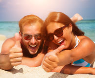 Couple in Sunglasses on the Beach. Happy Couple in Sunglasses having fun on the Beach Royalty Free Stock Image
