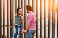 Couple and sunlight. Man and women standing. Date in the city Stock Images