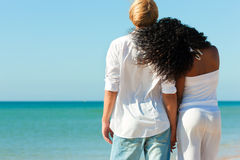 Couple on sunny beach in summer Royalty Free Stock Photo