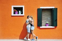 Couple in a sunny day in Burano, Venice, Italy. Couple in a sunny summer day in Burano, Venice, Italy Stock Photos