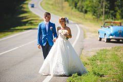 Couple on Sunny Road. Couple walking on sunny road Royalty Free Stock Photo