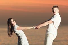 Couple at sunrise Stock Photo