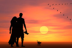 Couple at sunrise Stock Images