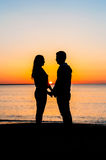 Couple at sunrise Stock Photography
