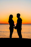 Couple at sunrise Stock Photos